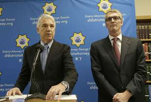 San Francisco District Attorney George Gascón, left, and FBI Special Agent in Charge David J. Johnson speak at a news conference in San Francisco, Tuesday, Feb. 16, 2016. (AP Photo/Jeff Chiu)