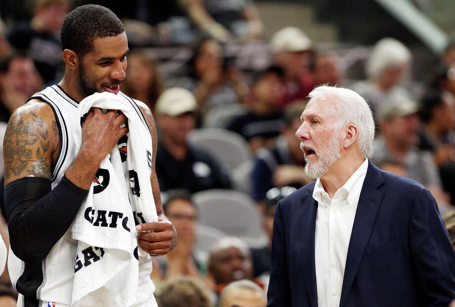 Spurs' LaMarcus Aldridge talks with head coach Gregg Popovich during first half action against the Pistons Sunday Oct. 18, 2015 at the AT&T Center. Photo: Edward A. Ornelas, Staff / San Antonio Express-News / © 2015 San Antonio Express-News