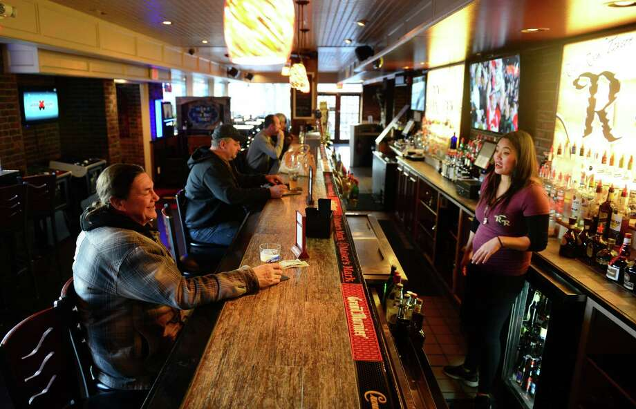Bartender Kim-anh Nguyen, right, chats with patron Otto Wendland, of Ansonia, at the newly-opended River Rock Tavern, a family-owned business in Derby, Conn. on Thursday Jan. 7, 2016. Photo: Christian Abraham / Hearst Connecticut Media / Connecticut Post