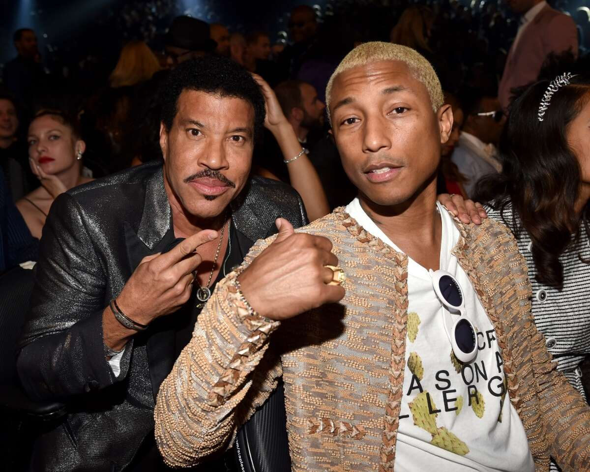Musicians Lionel Richie (L) and Pharrell Williams attend The 58th GRAMMY Awards at Staples Center on February 15, 2016 in Los Angeles.