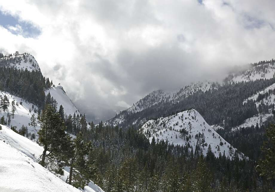 The sun beaks through the clouds over the snow covered Sierra Nevada near Echo Summit, Calif., Tuesday, Feb. 2, 2016. The California Department of Water Resources held it's second manual snow survey of the season, Tuesday,  which showed the snowpack at 130 percent of normal at the Phillips Station near Echo Summit. Photo: Rich Pedroncelli, Associated Press