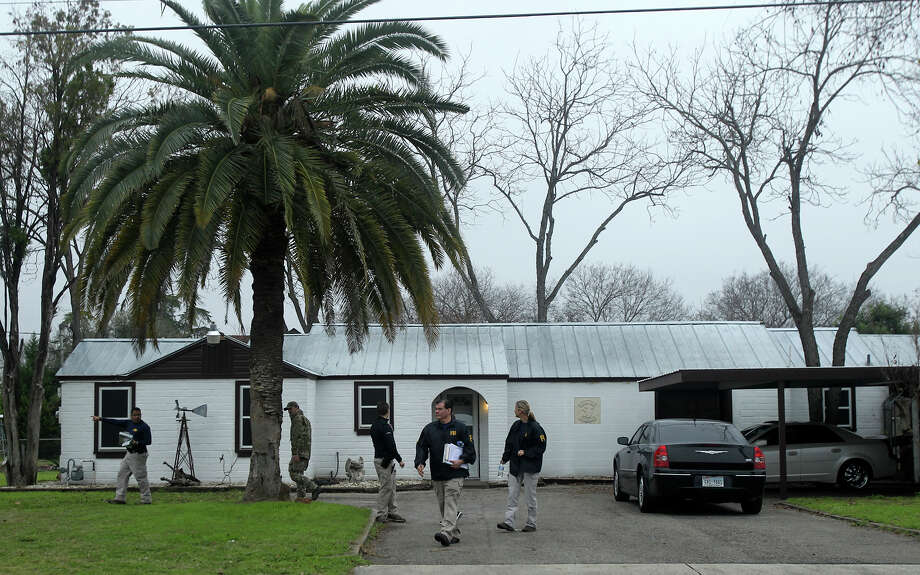 F.B.I. agents stand by a home located at 3003 Jupe Drive on San Antonio's South East Side where it is alleged that Bandidos Motocycle Club leader John X. Portillo lives. The agency said Portillo and the club's sergeant at arms, Justin Cole Forster, were taken into custody in San Antonio. Photo: John Davenport, Staff / San Antonio Express-News / ©San Antonio Express-News/John Davenport