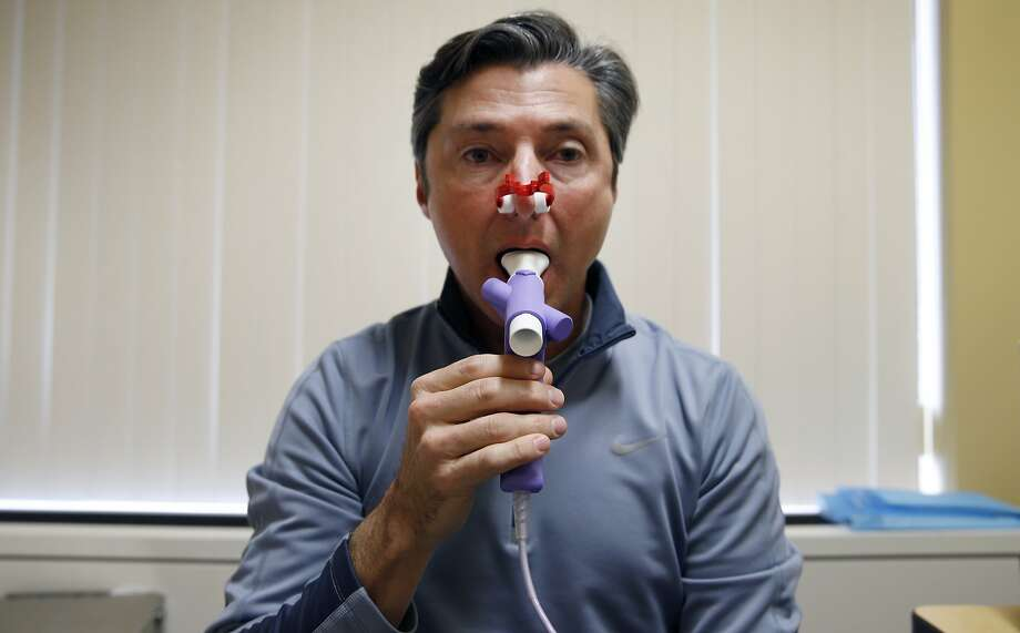 Rob Francis breathes into a pulmonary tube for the Cardia heart research at Kaiser Permanente Medical Center in Oakland, Calif. on Thursday, Jan. 28, 2016. The on-going project has been tracking the heart health of 5,000 participants nationwide for the past 30-years. Photo: Paul Chinn, The Chronicle