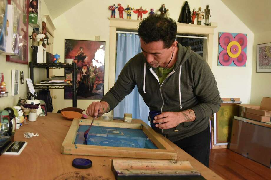 Ernesto Olivo is one of the artists participating in the On and Off Fredericksburg Road Tour. He spreads ink to be used in a screen printing in his studio on Friday, Feb. 12, 2016. Photo: Billy Calzada, Staff / San Antonio Express-News / San Antonio Express-News