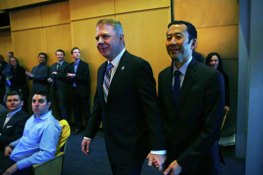Seattle Mayor Ed Murray enters council chambers with his husband Michael Shiosaki, before delivering his 2016 State of the City address, The Mayor spoke for nearly an hour, ranging over topics that included institutional racism, youth violence, housing affordability, equity, public safety, education, and homelessness. Photo: GENNA MARTIN, SEATTLEPI.COM / SEATTLEPI.COM