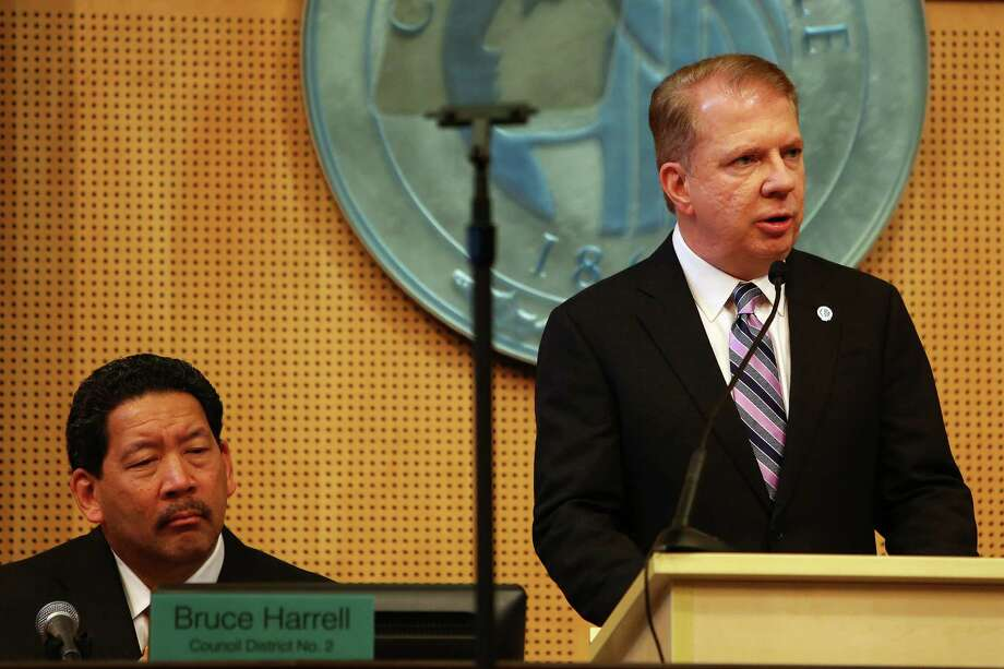 "Mayor Ed Murray and City Council President Bruce Harrell.  Along with Council member Tim Burgess, they have told Wells Fargo that Seattle will no longer have the bank as lender on a $100 million Seattle City Light bond issue.  The reason:  A national scandal over Wells Fargo employees opening bogus accounts in customers' names. The city leaders say Wells Fargo must mend its ways and ""make reparations."" Photo: GENNA MARTIN, SEATTLEPI.COM / SEATTLEPI.COM"