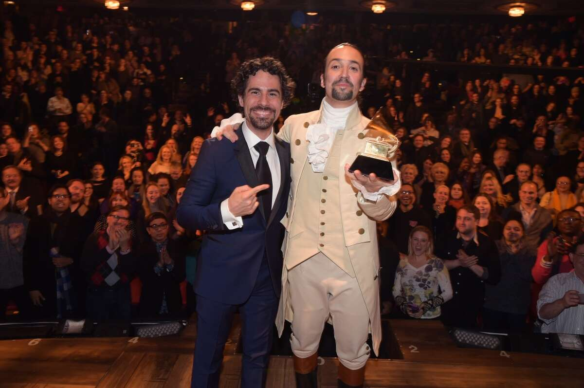Celebration Music director Alex Lacamoire and actor/composer Lin-Manuel Miranda celebrate on stage during the