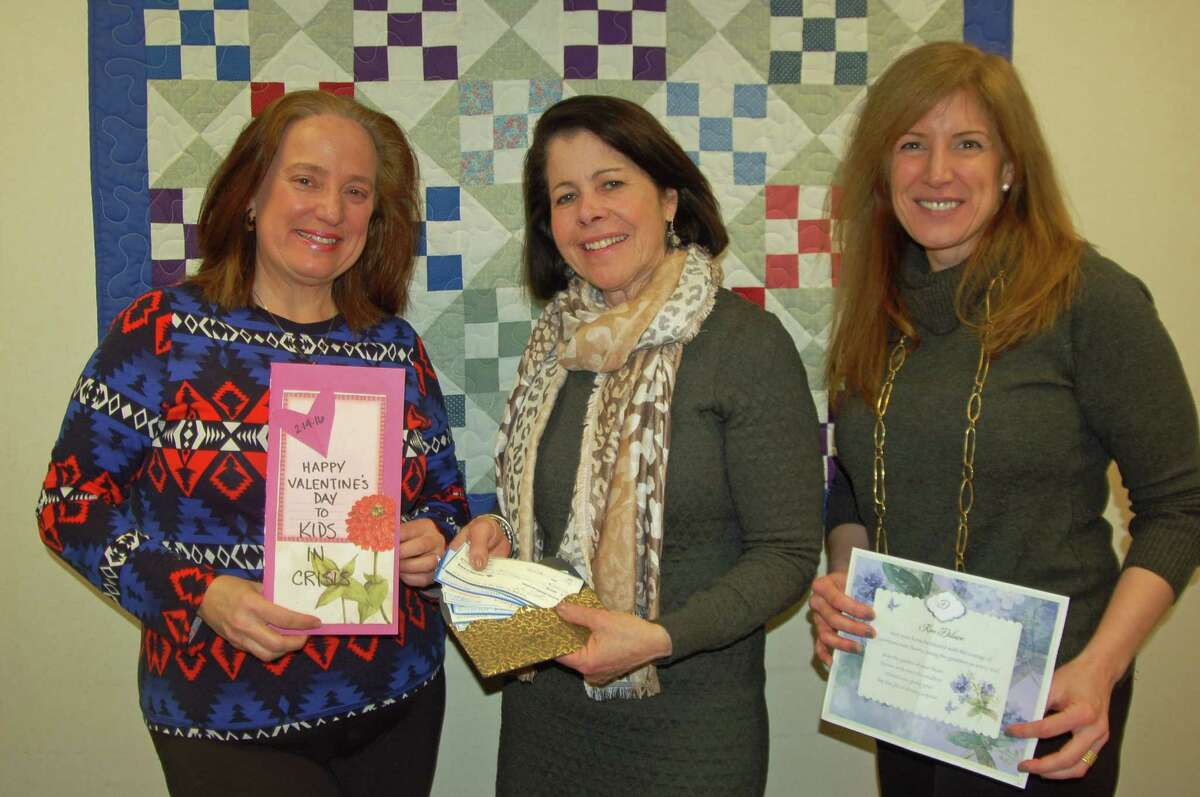 From left, Joan Stewart Pratt, Kids in Crisis Executive Director Shari Shapiro and Director of Counseling Services Kristen Tomasiewicz. Pratt presented Kids in Crisis with $800 in checks and valentine cards written by supporters