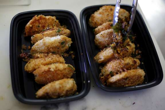Fried Idlis on a to-go tray at Kamakshi's Kitchen in San Carlos, California, on Tuesday, Feb. 16, 2016.