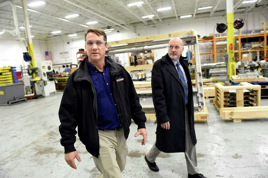Andy Ross, CEO of Ross Valve, left, takes Mayor Patrick Madden on a tour on Tuesday, Feb. 16, 2016, at RW Gate in Troy, N.Y. (Cindy Schultz / Times Union) Photo: Cindy Schultz / Albany Times Union