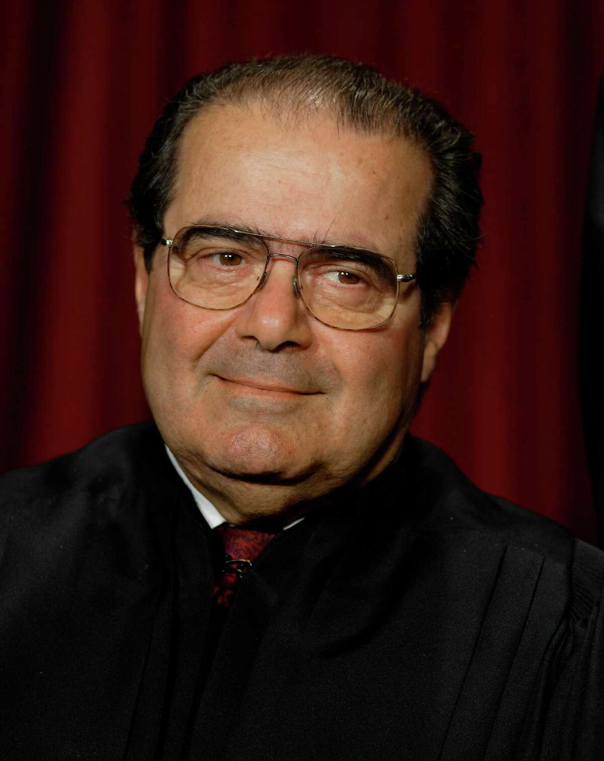 A shifting pillow Scalia was found in his bed with his head resting on three pillows, but at some point, the top pillow shifted under his head, which caused part of it to slide down and cover his face.