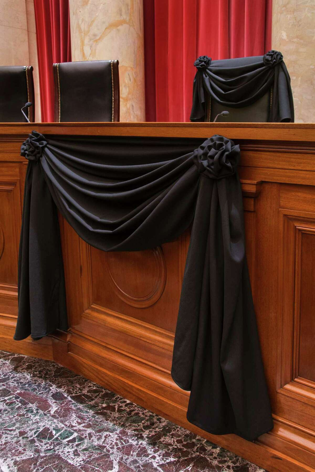 """This photo obtained February 16, 2016 courtesy of the US Supreme Court shows Supreme Court Associate Justice Antonin Scalias Bench Chair and the Bench in front of his seat draped in black following his death on February 13, 2016. The sudden death of Justice Antonin Scalia, a towering conservative icon on the US Supreme Court, has set off an epic election-year battle over his successor that will shape American life far into the future.Scalia died of an apparent heart attack at age 79, leaving what had been a conservative-dominated court evenly divided in a year of blockbuster cases -- on abortion, affirmative action, immigration and President Barack Obama's health care law. / AFP / Supreme Court of the United States / Supreme Court of the United Stat / RESTRICTED TO EDITORIAL USE - MANDATORY CREDIT """"AFP PHOTO / US SUPREME COURT"""" - NO MARKETING NO ADVERTISING CAMPAIGNS - DISTRIBUTED AS A SERVICE TO CLIENTS SUPREME COURT OF THE UNITED STAT/AFP/Getty Images"""