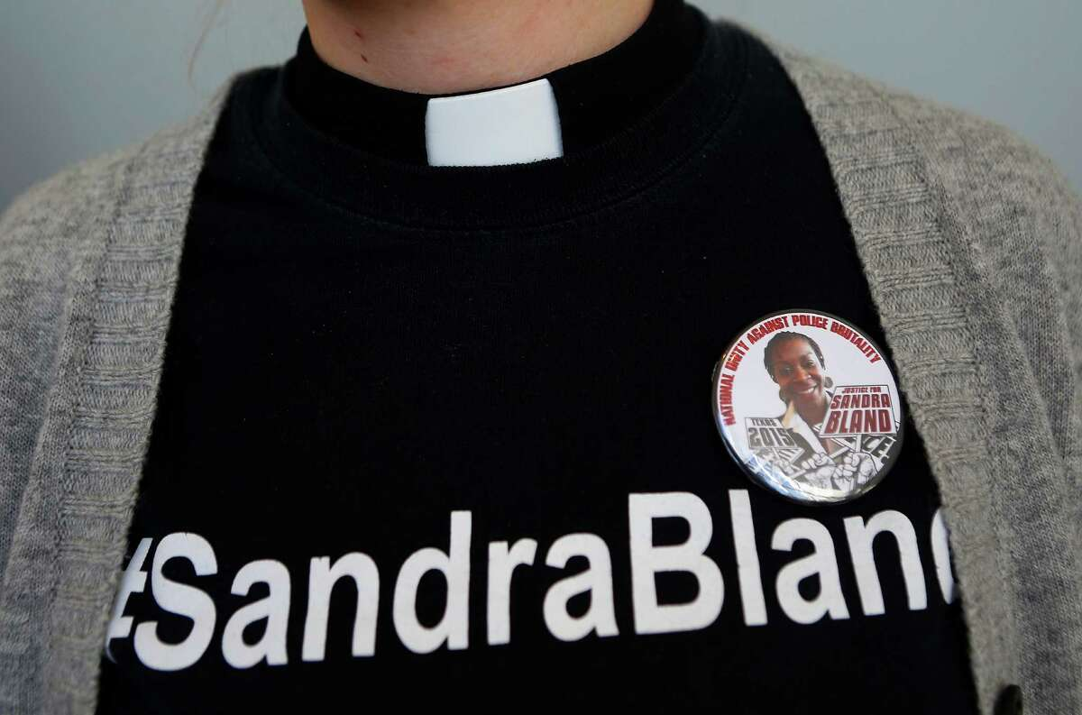 The Rev. Hannah Bonner attends the press conference wearing a shirt honoring Sandra Bland, who died while in the Waller County jail last year.