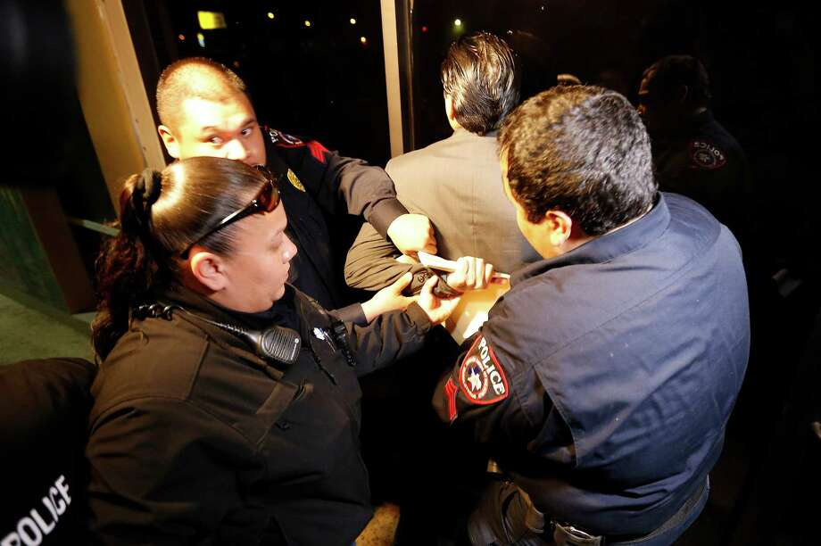Crystal City Mayor Ricardo Lopez is handcuffed and taken away from city hall by police after a scuffle with citizens during a heated council meeting to suspend city manager James Jonas III and to force a recall election after Jonas and three city council members were faced federal corruption charges on Tuesday, Feb. 16, 2016. Photo: Kin Man Hui, San Antonio Express-News / ©2016 San Antonio Express-News