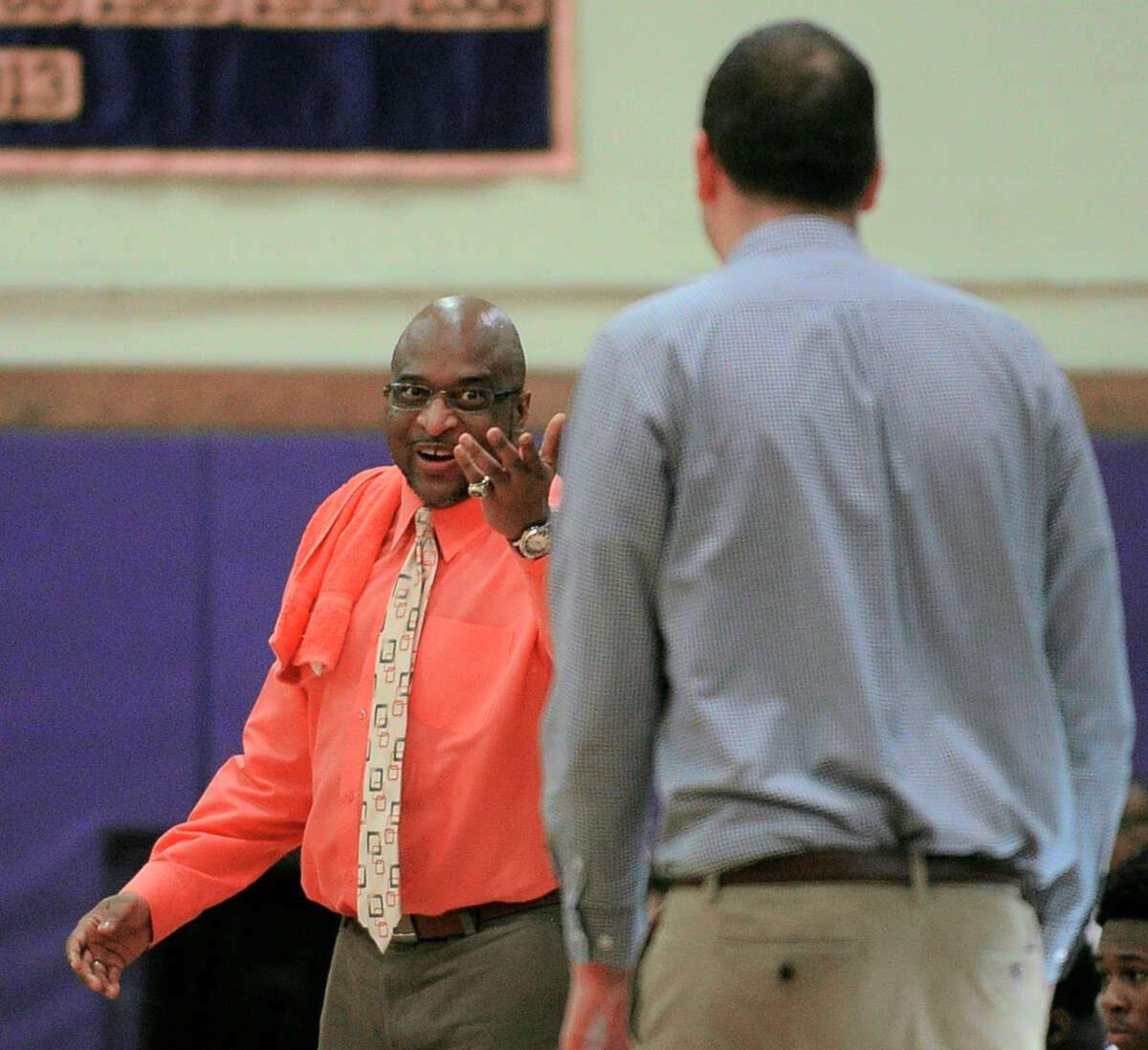 Westhill coach Howard White and Norwalk coach Tom Keyes exchange words in the first half of a FCIAC boys basketball game in Stamford, Conn. on Feb. 16, 2016. Westhill defeated Norwalk 55-46.
