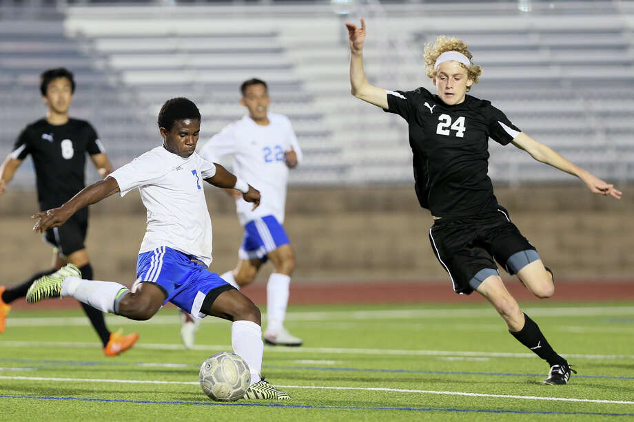 Jay's Enoc Rochez (left) shoots at the Clark goal as Clark's Jon Connor Rule defends during their District 27-6A soccer match at Gustafson Stadium on Feb. 16, 2016. Photo: Marvin Pfeiffer /San Antonio Express-News / Express-News 2016