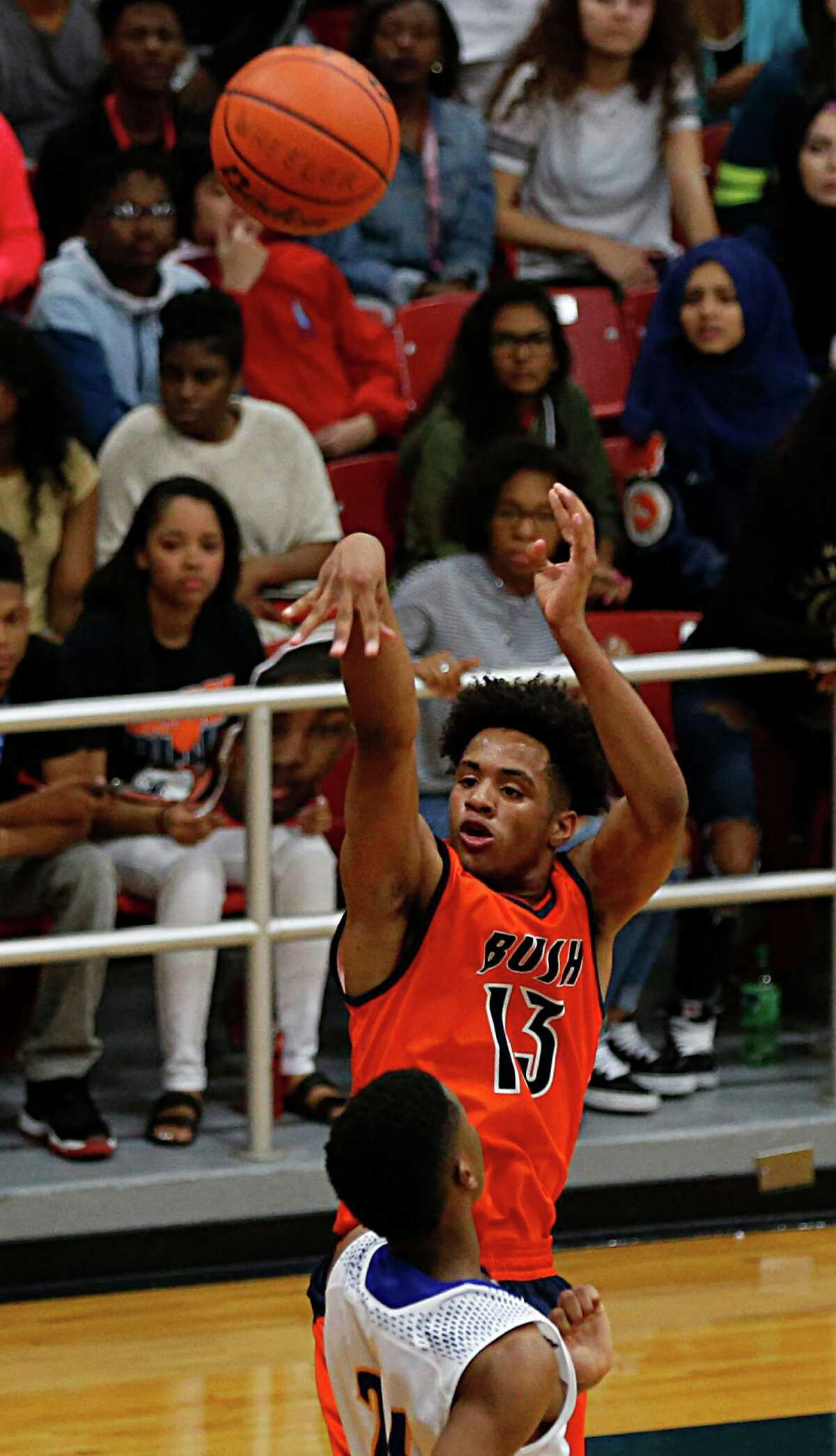 Bush's Bryson Etienne right, shoots over Elkins Tyrik Armstrong right, during the second half of boy's high school basketball game action at Wheeler Field House Tuesday, Feb. 16, 2016, in Sugar Land.
