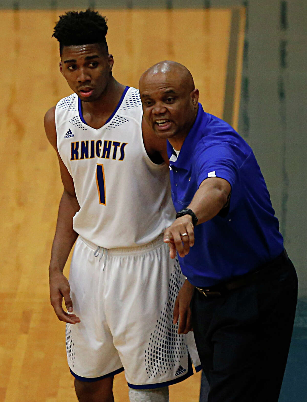 Elkins head coach Albert Thomas right, and Noel Pinnock during the first half of boy's high school basketball game action against Elkins at Wheeler Field House Tuesday, Feb. 16, 2016, in Sugar Land.