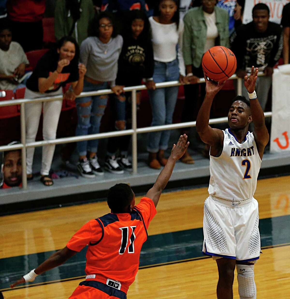 Elkins Kenneth Busby right, shoots over Bush's Remy Minor left, during the first half of boy's high school basketball game action at Wheeler Field House Tuesday, Feb. 16, 2016, in Sugar Land.