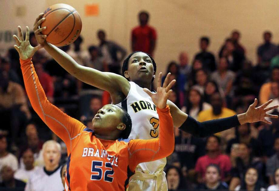 Hornets forward Nalyssa Smith swipes a rebound from Breauna Delon as East Central hosts Brandeis on Feb. 16. Photo: Tom Reel /San Antonio Express-News / 2016 SAN ANTONIO EXPRESS-NEWS
