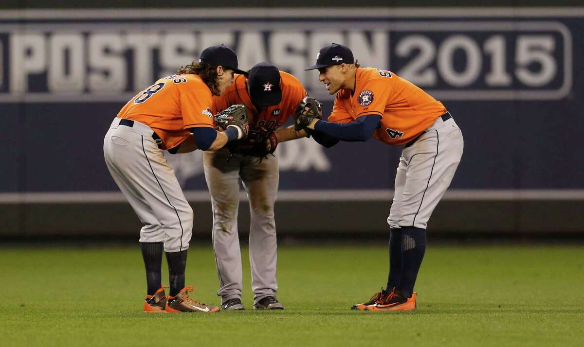 Colby Rasmus, left, having bonded with teammates like Jake Marisnick, center, and George Springer, felt compelled to return to the Astros instead of testing the free-agent waters in the offseason.