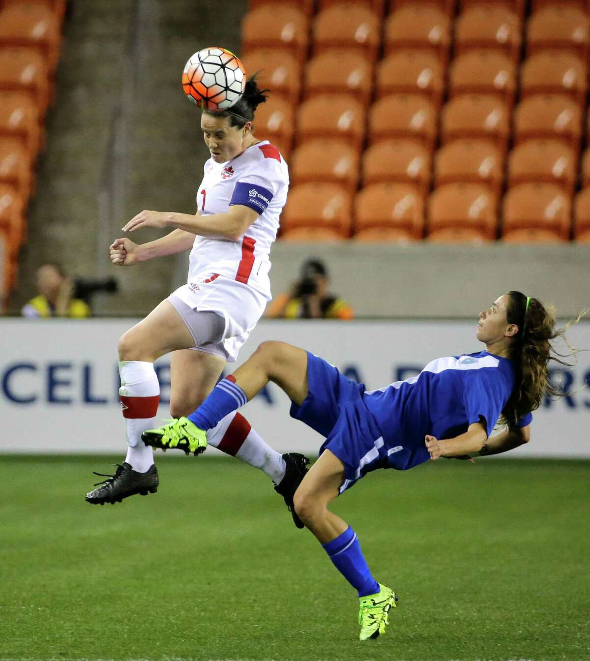 Rhian Wilkinson has no trouble getting off a header over Guatemala's Daniela Andrade during Canada's 10-0 victory Tuesday night at BBVA Compass Stadium that continued the dominance of the Canadians and Americans in the Olympic qualifying tournament.