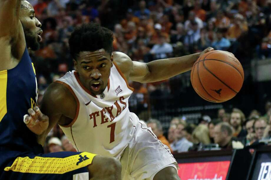 AUSTIN, TX - FEBRUARY 16: Isaiah Taylor #1 of the Texas Longhorns drives around Tarik Phillip #12 of the West Virginia Mountaineers at the Frank Erwin Center on February 16, 2016 in Austin, Texas. Photo: Chris Covatta, Getty Images / 2016 Getty Images