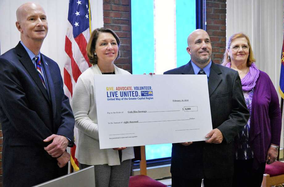From left:  United Way of the Greater Capital Region CEO Brian Hassett, left, Mayor Joanne Yepsen, Shelters of Saratoga's Mike Finocchi, and Code Blue Saratoga director Cheryl Ann Murphy-Parant with a ceremonial check from United Way during a news conference Tuesday Feb. 16, 2016 in Saratoga Springs, NY.  (John Carl D'Annibale / Times Union) Photo: John Carl D'Annibale / 10035446A