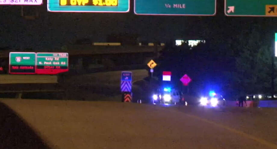 A fatal motorcycle crash Tuesday night, Feb. 16, 2016, led to two other crashes involving police squad cars and one injured officer on Interstate 10 near the 610 Loop in west Houston. Photo: Metro Video
