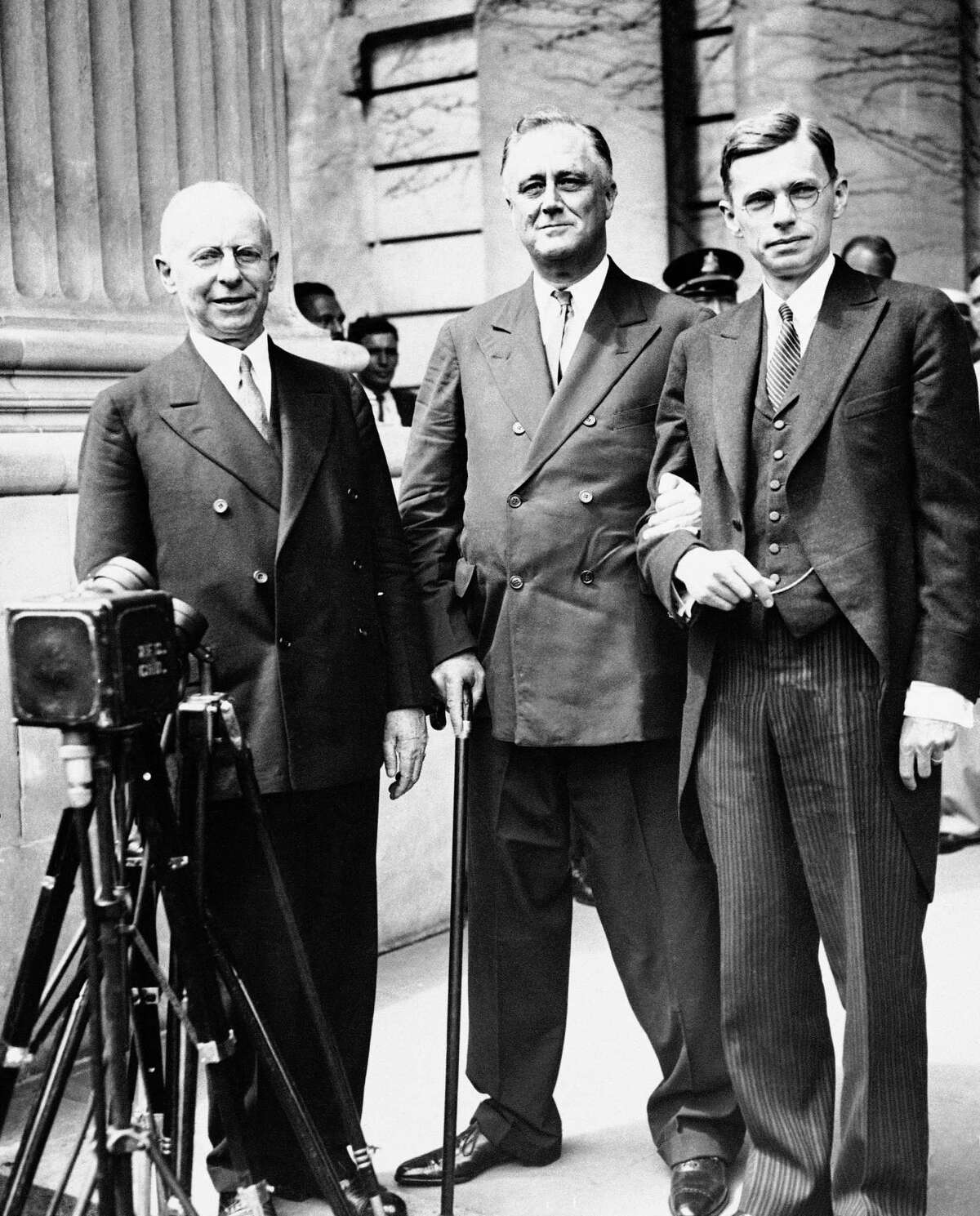 President Franklin D. Roosevelt, is shown just after he received the honorary degree of Doctor of Laws from Yale University, New Haven, Conn., June 20, 1934. From left to right: President James Rowland Angell of Yale; Pres. Roosevelt; and President James Bryant Conant of Harvard University, who also received an honorary degree from Yale.