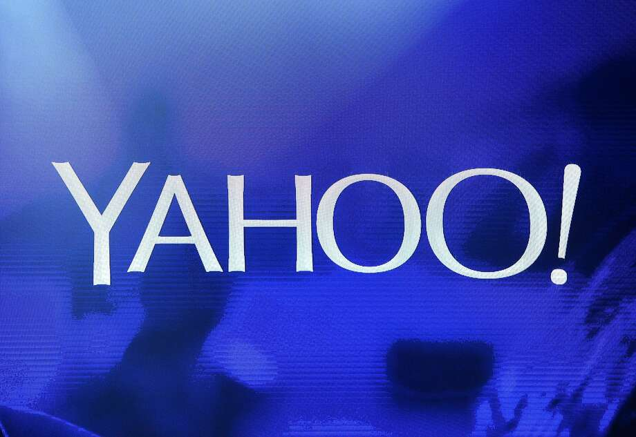 A Yahoo logo is shown on a screen during a keynote address by Yahoo CEO Marissa Mayer at the 2014 International CES at The Las Vegas Hotel & Casino in Las Vegas, Nevada. Photo: Ethan Miller