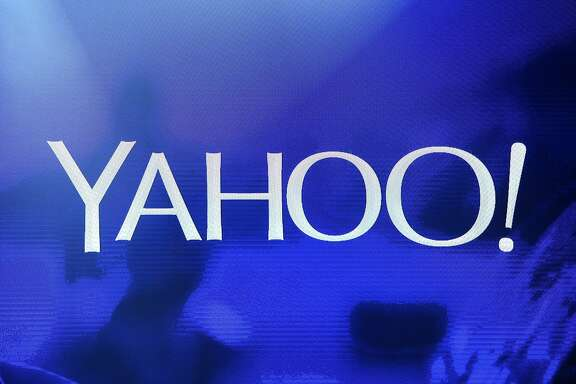 A Yahoo logo is shown on a screen during a keynote address by Yahoo CEO Marissa Mayer at the 2014 International CES at The Las Vegas Hotel & Casino in Las Vegas, Nevada.  (Photo by Ethan Miller/Getty Images)