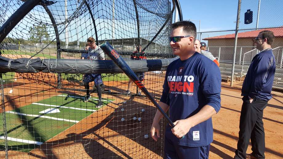 Astros manager A.J. Hinch cracks a smile behind the batting cage during an informal spring workout Wednesday in Kissimmee, Fla. (Evan Drellich / Houston Chronicle)