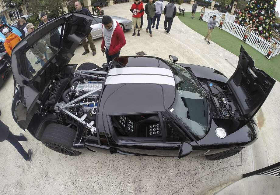 The Ride and Shine Car Show will be Feb. 20 from 8-10 a.m. in the courtyard of La Centerra at Cinco Ranch. Above, car enthusiasts check out a Ford GT 350 owned by  M2K Motorsports at an earlier car show. Photo: Diana L. Porter, Freelance / © Diana L. Porter
