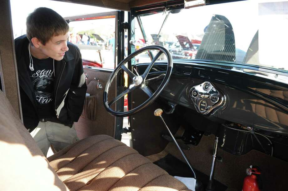 The seventh annual Heritage at Towne Lake Car Show will be Feb. 27 from 11 a.m.-4 p.m. Above, Dylan Rice checks out the inside of a 1929 Ford sedan during an earlier car show at Towne Lake. Photo: Thomas Nguyen, Freelance / Freelance