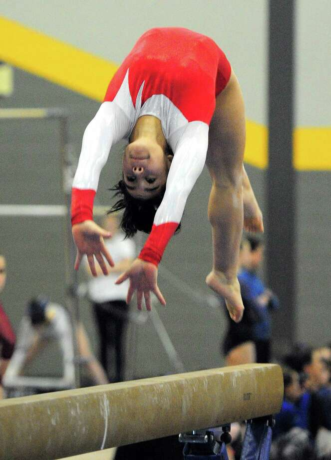 Greenwich's Adnerys DeJesus performs on the balance beam Saturday. Photo: Christian Abraham / Hearst Connecticut Media / Connecticut Post