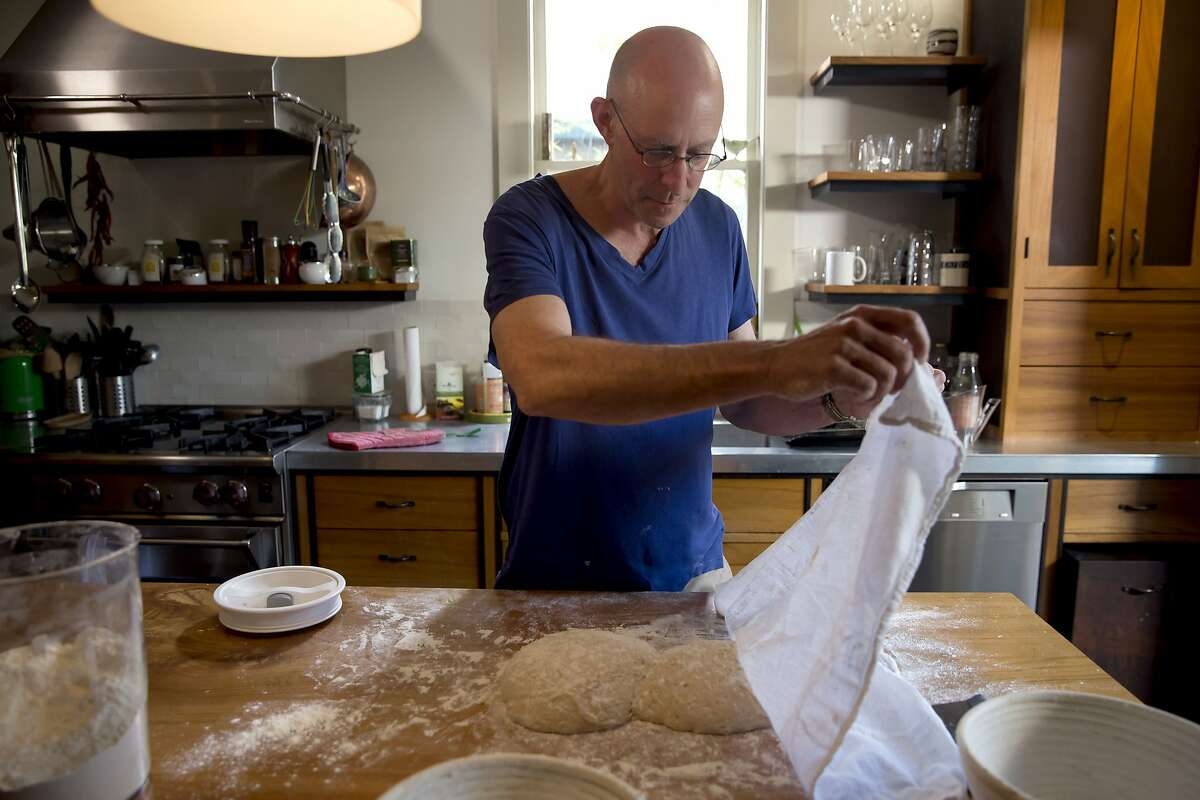 """Michael Pollan making bread in his Berkeley kitchen for """"Cooked,"""" a new Netflix documentary series airing February 19, 2016."""