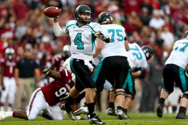 COLUMBIA, SC - NOVEMBER 23:  Alex Ross #4 of the Coastal Carolina Chanticleers drops back to pass during their game against the South Carolina Gamecocks at Williams-Brice Stadium on November 23, 2013 in Columbia, South Carolina.