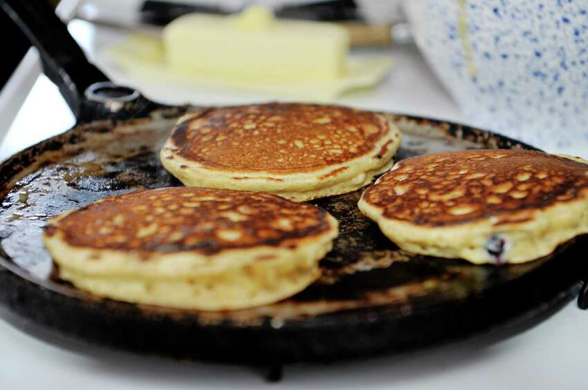 Amy Halloran makes pancakes at her home on Thursday, Feb. 11, 2016, in Troy, N.Y. The pancakes were made with Farmer Ground Flour, pastry wheat. (Paul Buckowski / Times Union)