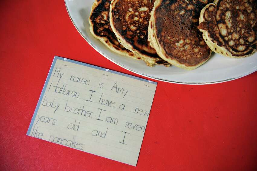 A view of pancakes made by Amy Halloran at her home on Thursday, Feb. 11, 2016, in Troy, N.Y. The pancakes were made with Farmer Ground Flour, pastry wheat. The card on the table is a photograph of a short autobiography Halloran wrote when she was in the second grade. (Paul Buckowski / Times Union)
