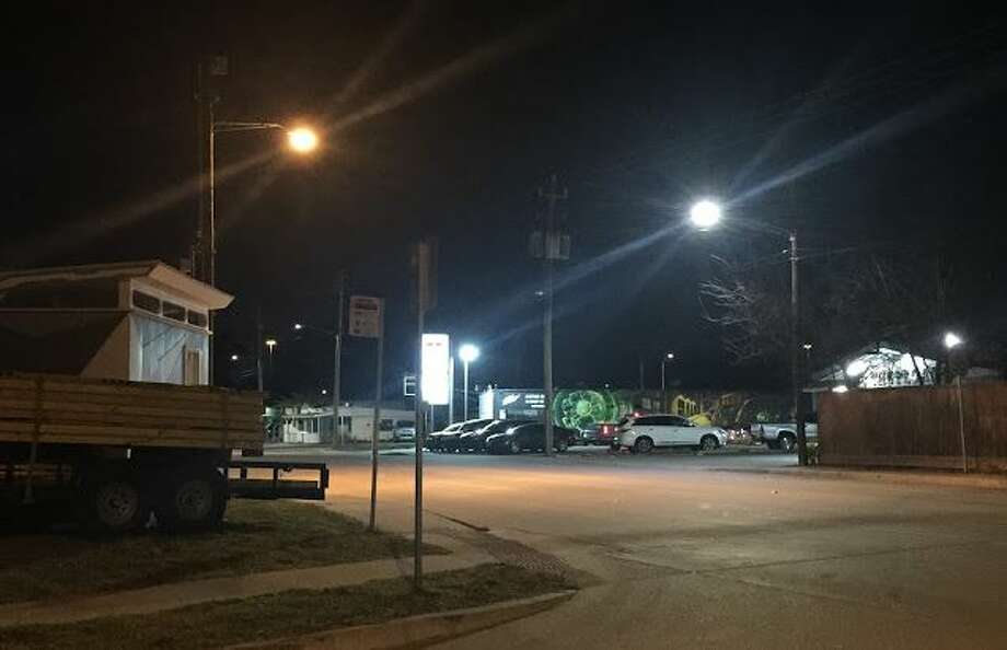 A high-pressure sodium light (left) and a new LED light (right) on North Main Street at East 24th Street. Photo: Christopher Andrews