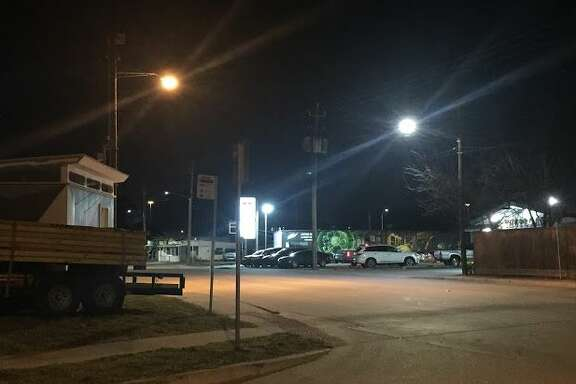 A high-pressure sodium light (left) and a new LED light (right) on North Main Street at East 24th Street.