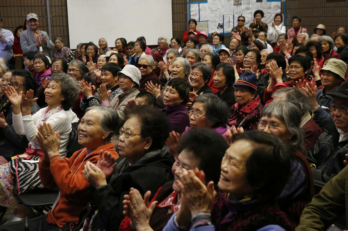 Community members applaud during an event where the San Francisco Zoo & Gardens presented 300 seniors from the S.F. Community Tenants Association with free Zoo tickets at the Willie Woo Woo Wong Chinese playground Feb. 17, 2016 in San Francisco, Calif. The Zoo brought a kinkajou named Harley to the event.