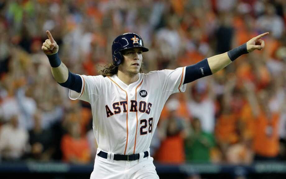 Houston Astros' Colby Rasmus celebrates after hitting a solo home run against the Kansas City Royals in the seventh inning during Game 4 of American League Division Series on Oct. 12, 2015, in Houston. Photo: Pat Sullivan /Associated Press / AP
