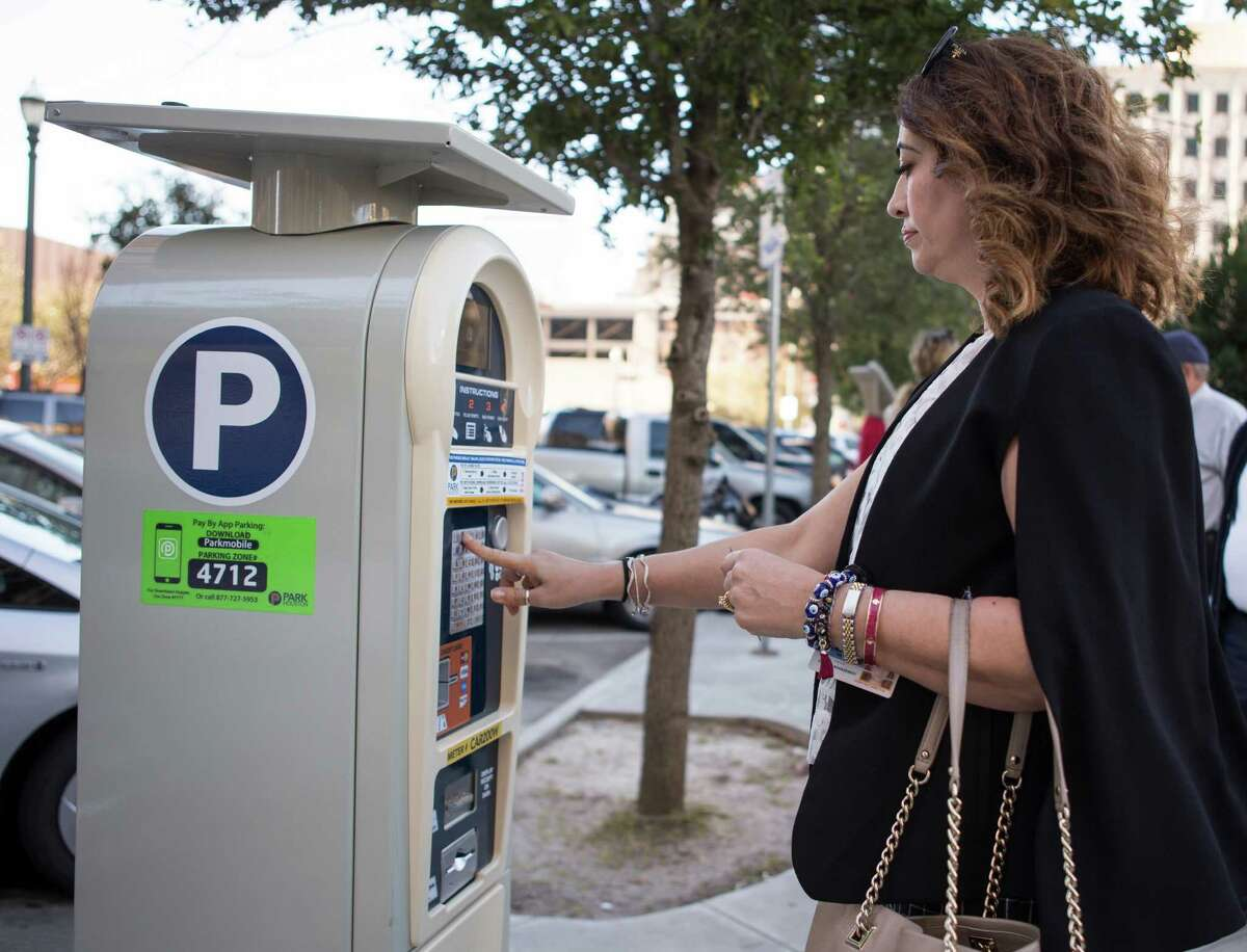 Maria Irshad, assistant director ParkHouston, demonstrates how to use the city's new parking meters onFeb. 16. The city is in the process of installing 276 new meters downtown, starting in the area around the Harris County Courthouse.
