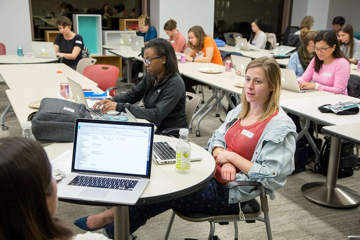 Software developer Rae Bonfanti listens to Stitch Fix software engineer Emma Colner during a Women Who Code seminar in San Francisco.