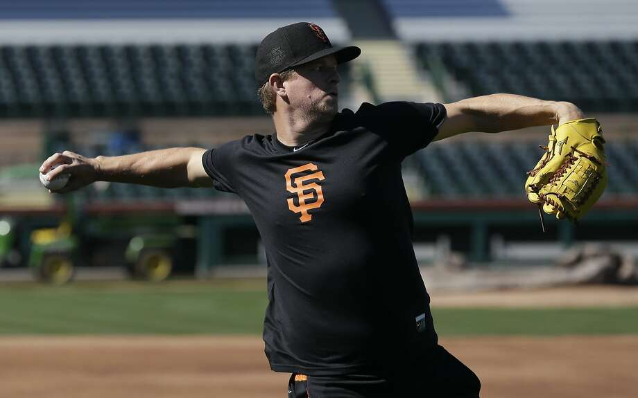 The cyst on the upper part of Matt Cain's right arm did not bother him initially when he threw in camp, Bruce Bochy said. Photo: Chris Carlson, Associated Press