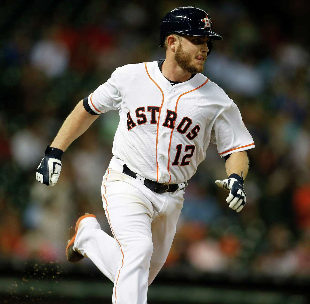 Houston Astros catcher Max Stassi (12) runs to first on his RBI single during the second inning of an MLB baseball game at Minute Maid Park on Tuesday, Sept. 1, 2015.( Karen Warren / Houston Chronicle )