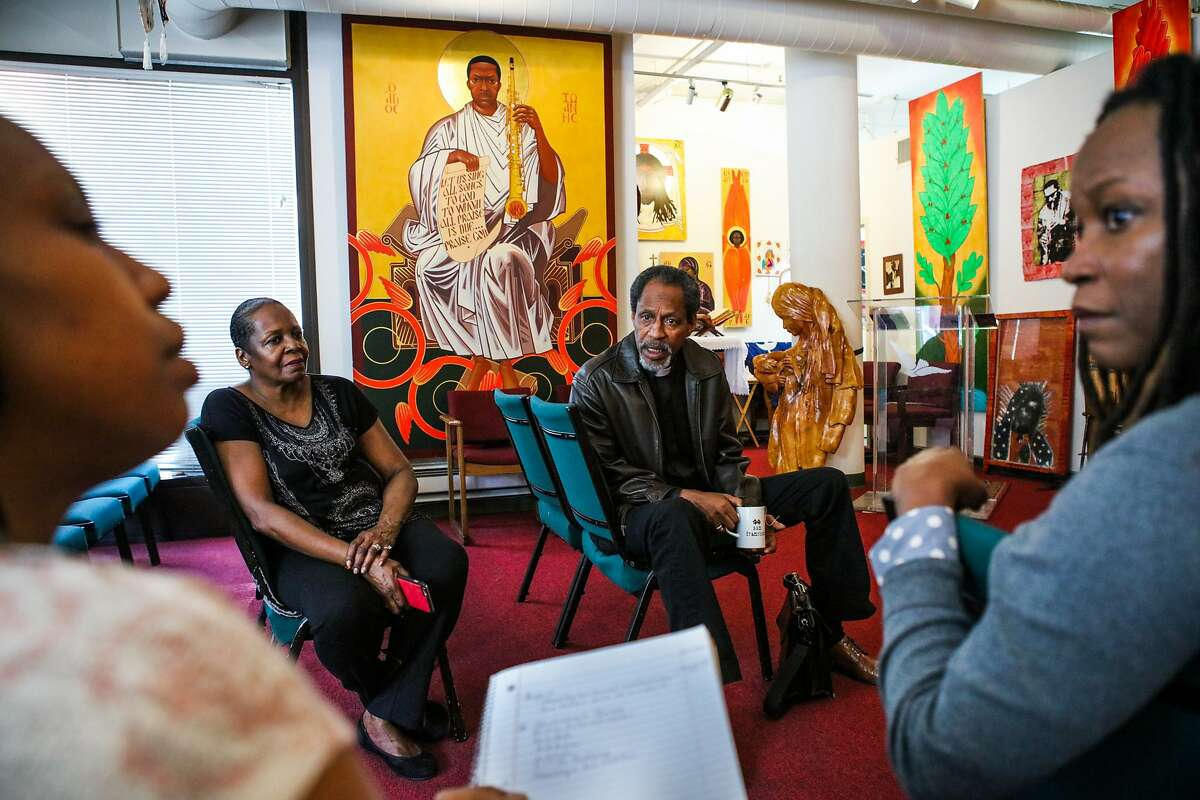 (l-r) Reverend Marlee-I Mystic, Supreme Mother Marina King, Reverend Archbishop Franzo W. King, and Reverend Wanika Stephens have a meeting in the chapel of the St. John Coltrane African Orthodox Church in San Francisco, California on Wednesday, February 17, 2016.