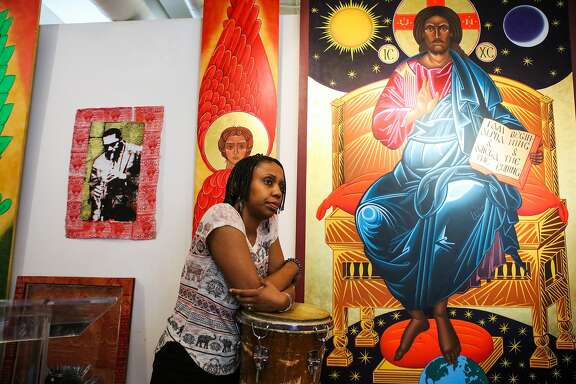 Reverend Marlee-I Mystic rests on the drums after a meeting with her colleagues at the St. John Coltrane African Orthodox Church in San Francisco, California on Wednesday, February 17, 2016.